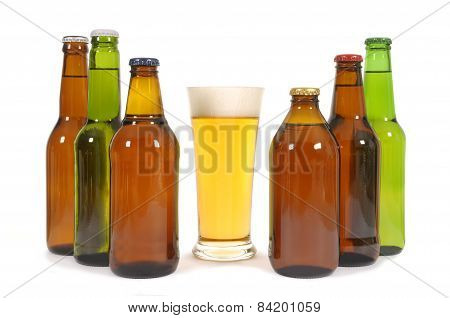 Glass of beer surrounded by several different bottles against a white background poster