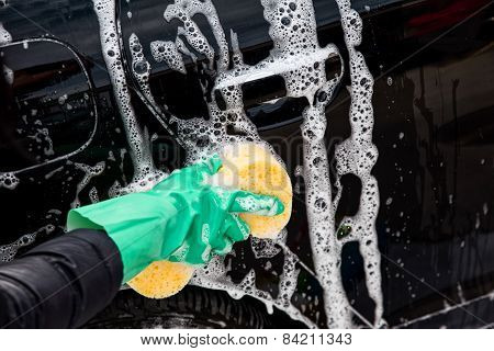 Outdoor car wash with yellow sponge