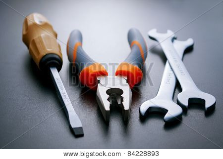 Three Different Hand Tools On A Gray Background