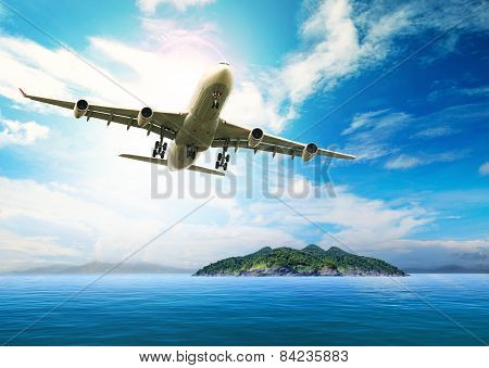 Passenger Plane Flying Over Beautiful Blue Ocean And Island In Purity Destination Sea Beach Use For