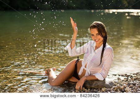 Preety Woman In Swimsuit Near Alpine River In Early Summer