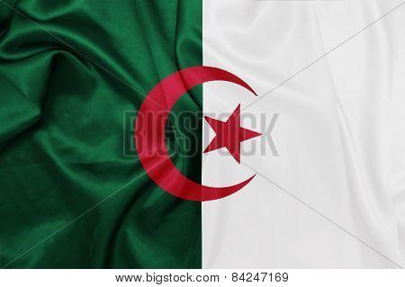 Algeria - Waving national flag on silk texture
