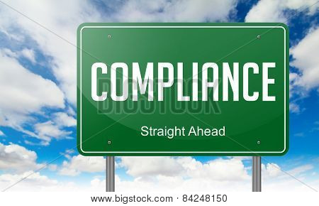Compliance on Green Highway Signpost.