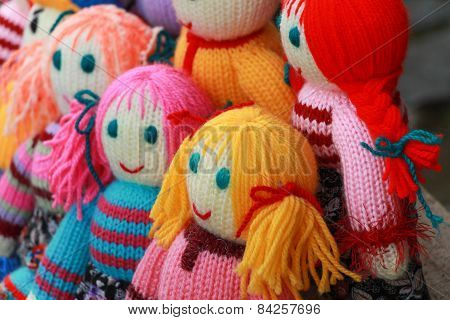 Handmade toys. Homemade knitted doll. Colorful dolls. poster