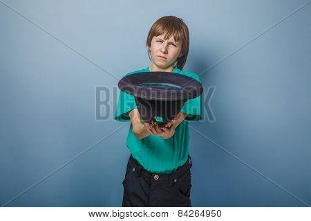European-looking boy of ten years to ask for  money, hat, beggar
