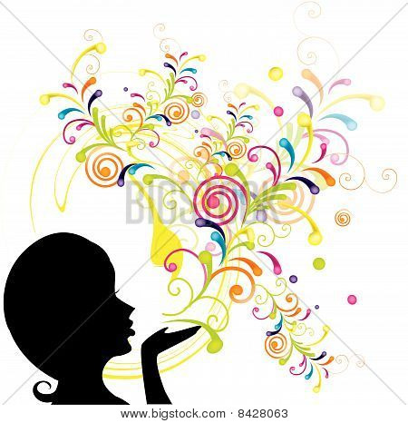 Young girl blowing abstract floral