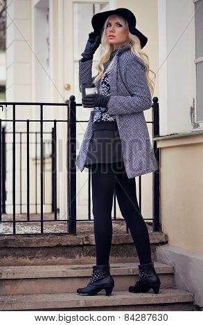 Beautiful Blonde Girl With Coffee