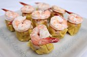 Shrimp stream and put on top dim sum on white plate. poster