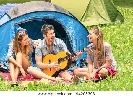 Group Of Best Friends Singing And Having Fun Camping Together - Concept Of Carefree Youth Freedom