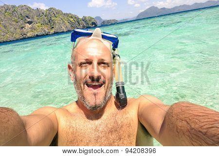 Handsome Man Taking A Selfie During Islands Hopping At El Nido In Palawan - Boat Trip Snorkeling