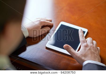 Man working with the tablet