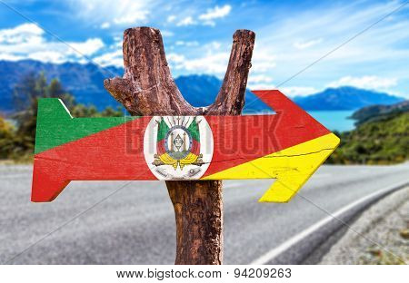 Rio Grande do Sul wooden sign with road background