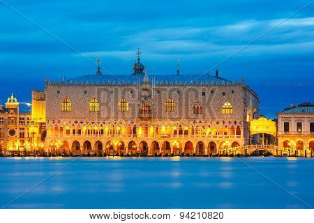 View from the sea to Venice with Doges Palace and Ponte dei Sospiri at night, Venice, Italy poster