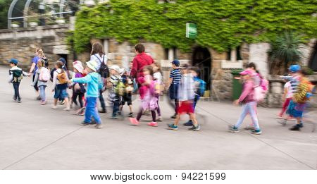 Group Of Chidren  Walking In The Park