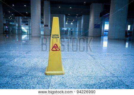 slippery sign on floor of modern building