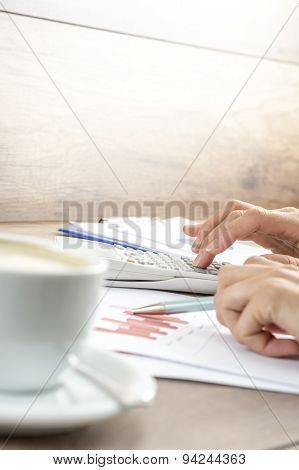 Closeup Of Female Hands Making Mathematical And Statistical Calculations