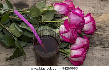 Beautiful Union Of Roses And Glass Of Juice