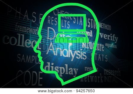 Laptop in head against computing buzzwords on black background