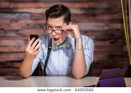 Insulted Boyish Woman Looking At Phone