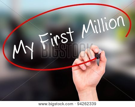 Man Hand writing My First Million with black marker on visual screen.