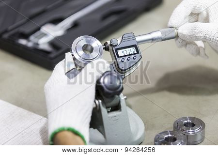 Operator Inspection Automotive Part By Micrometer