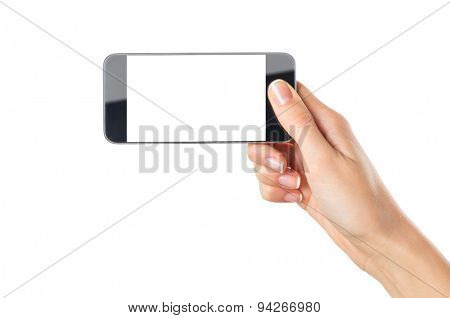 Closeup shot of a woman showing modern mobile phone isolated on white background. Girl holding a smartphone with white screen in horizontal. Young woman's hand showing an horizontal cellphone.