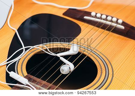 earphone on guitar,selective focus
