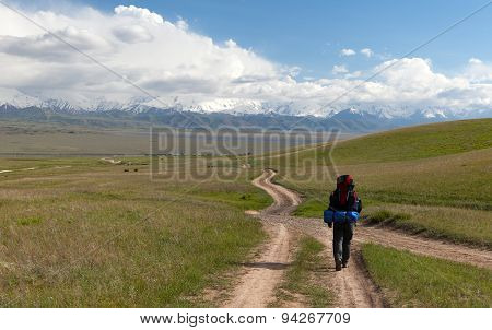 Man On Way In Steppe And Pamir Mountains - Kyrgyzstan