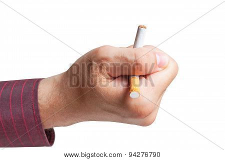 Man breaks a cigarette in his hand