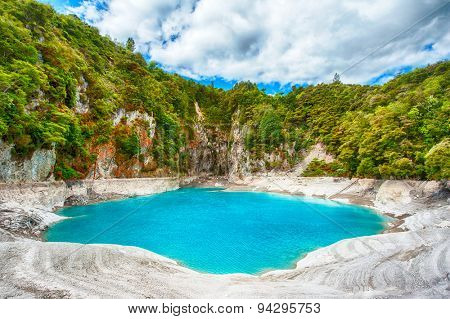 Incredibly blue and highly acidic Inferno Crater Lake at Waimangu geothermal area, New Zealand