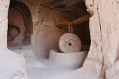 antique stone grinder grinding wheat from ancient time in Cappadocia, Turkey poster