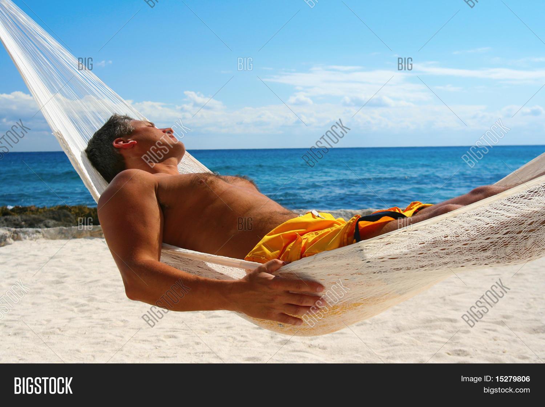 man sunbathing in a hammock man sunbathing hammock image  u0026 photo   bigstock  rh   bigstockphoto