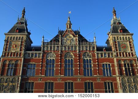 Amsterdam Central Train Station(Centraal) in Amsterdam, Netherlands. Sunset light. Central Station is the central railway station of Amsterdam and is used by 250000 passengers a day.