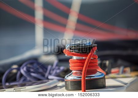 Sailboat winch and rope yacht detail. Yachting on the Sea.