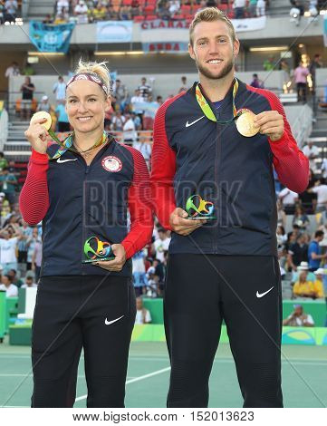 RIO DE JANEIRO, BRAZIL - AUGUST 14, 2016: Olympic champions Bethanie Mattek-Sands (L) and Jack Sock of United States during medal ceremony after victory at mixed doubles final of the Rio 2016 Olympics