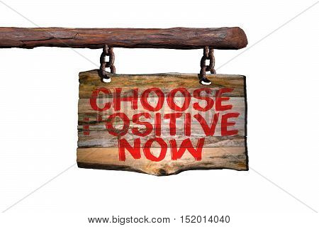 Choose positive now motivational phrase sign on old wood with blurred background