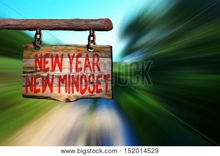 New year new mindset motivational phrase sign on old wood with blurred background