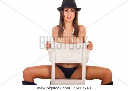 Cute Brunette On The Chair