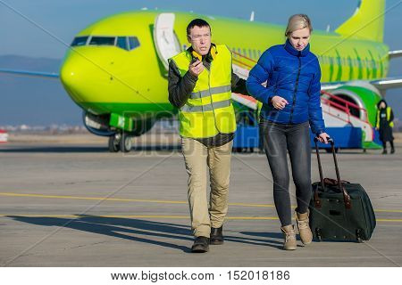 arrested woman escorted with an airport worker