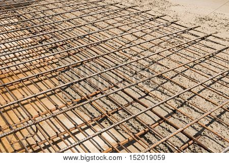 The wet concrete is poured on a steel reinforcement to form strong floor slabs.