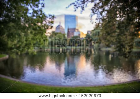 blurred background in Boston Public Garden. blurred pond and trees in Boston common park at sunset