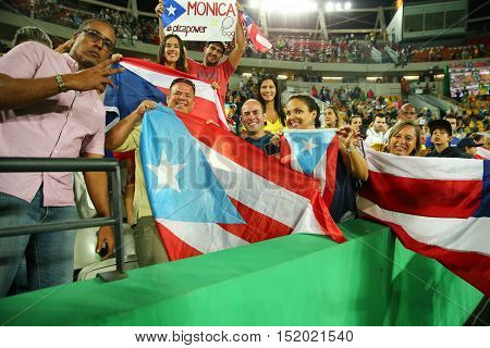 RIO DE JANEIRO, BRAZIL - AUGUST 13, 2016: Puerto Rican fans support olympic champion Monica Puig of Puerto Rico during tennis women's singles final of the Rio 2016 Olympic Games