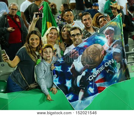 RIO DE JANEIRO, BRAZIL - AUGUST 8, 2016: Tennis fans support Olympic champion Serena Williams of United States during singles round two match of the Rio 2016 Olympic Games at the Olympic Tennis Centre