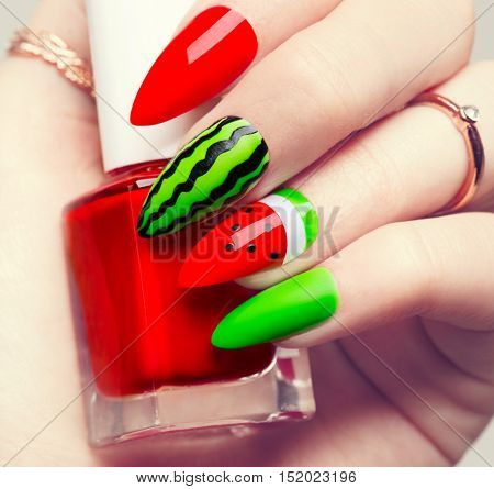 Nail art manicure. Watermelon style bright summer or autumn Art Manicure for long nails. Nail Polish. Beauty hands. Trendy Stylish Colorful Nails and Nailpolish