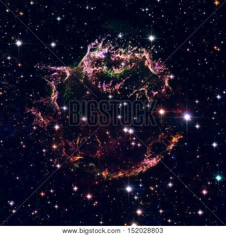 The tattered remains of a supernova explosion known as Cassiopeia A. It is the youngest known remnant from a supernova explosion in the Milky Way. Elements of this image furnished by NASA.