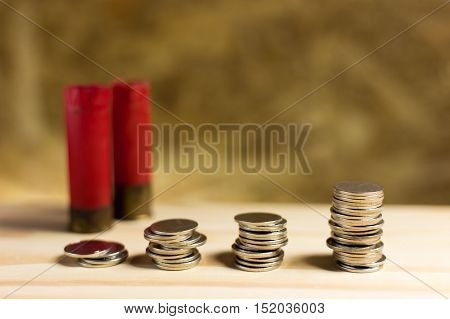 Still Life.staircase Of Money, Thai Coins Of One Bath On Wood And Shotgun Shell Background.concept O
