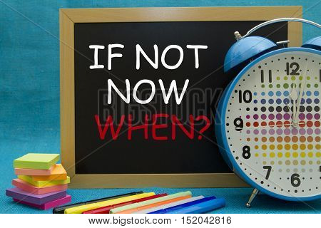 If not now when? message written on a small blackboard.