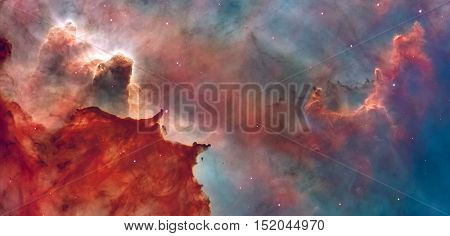 Star Birth in the Carina Nebula or Grand Nebula. Large bright nebula that has within its boundaries several related open clusters of stars. Retouched image. Elements of this image furnished by NASA.
