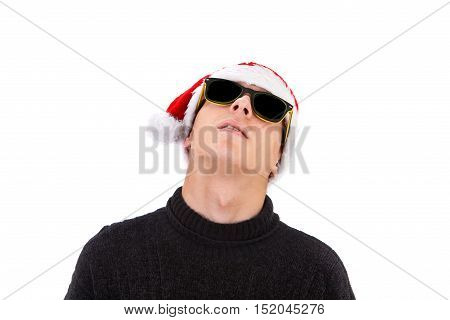Young Man in Santa Hat and Sunglasses Isolated on the White Background