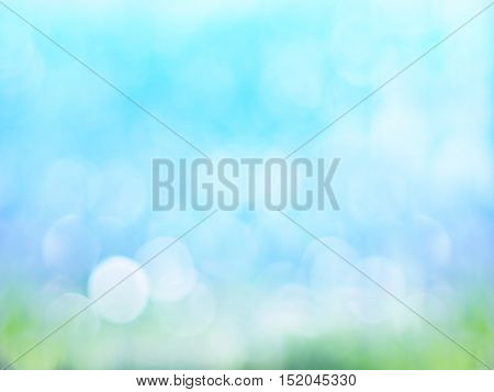 Abstract green and blue background with bokeh and sun rays for spring season concept.